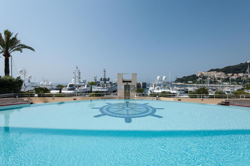 The swimming pool at or near Le Quai Des Princes