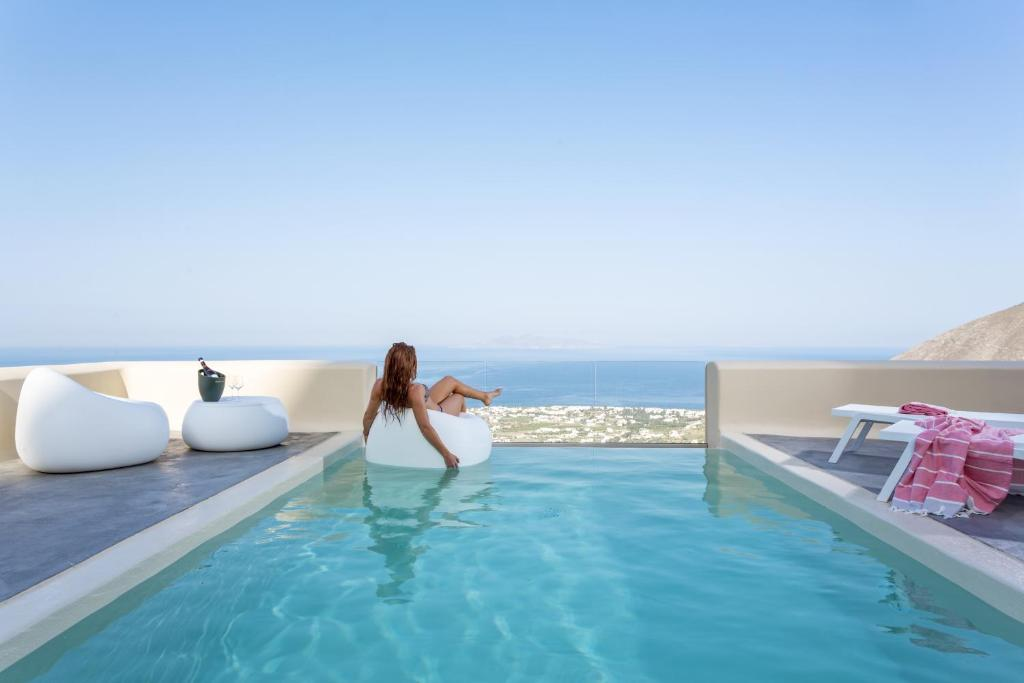 The swimming pool at or near Skyfall Suites - Adults Only