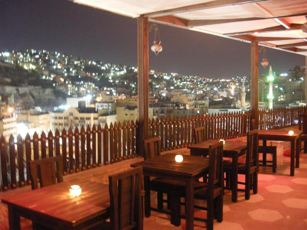 A restaurant or other place to eat at Arab Tower Hotel