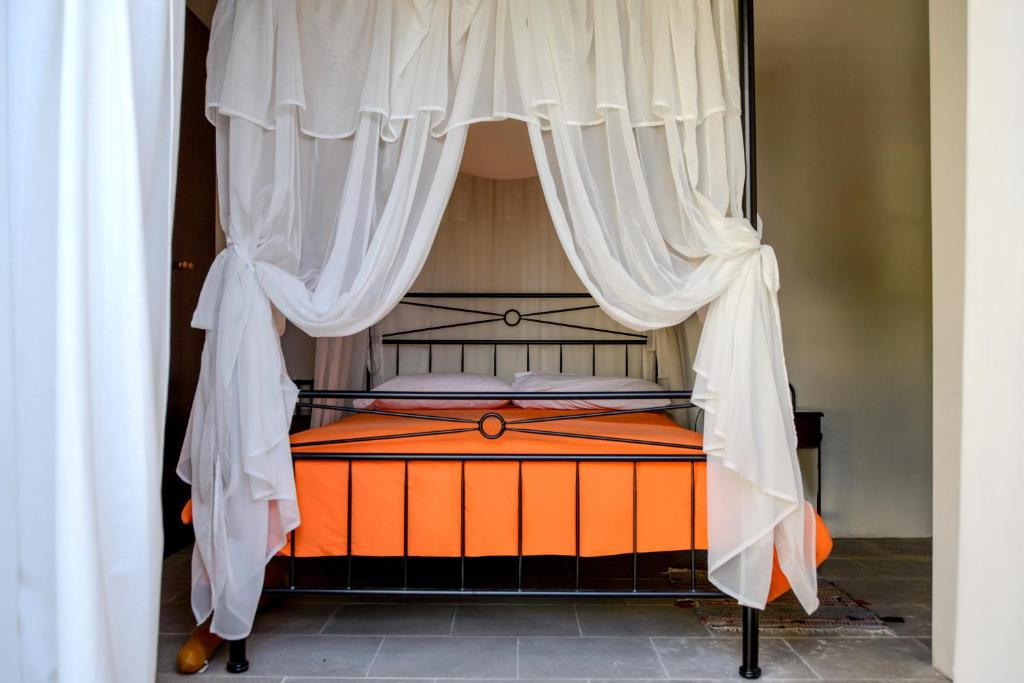 A bed or beds in a room at Kozakos Luxury House