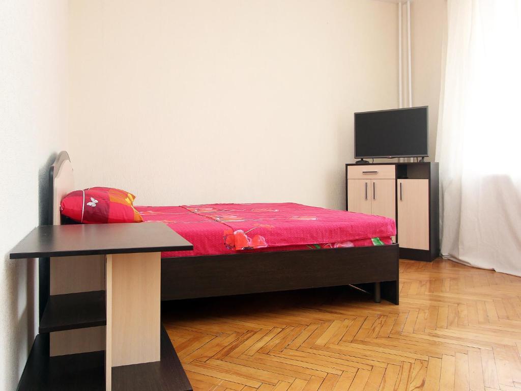 Кровать или кровати в номере ApartLux Leninsky Suite
