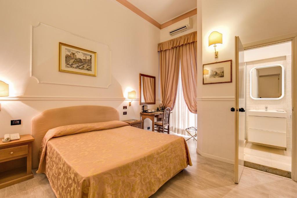 Letto o letti in una camera di Hotel Martini