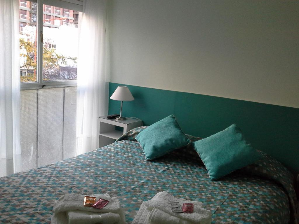 A bed or beds in a room at M&A Apartamentos Temporales