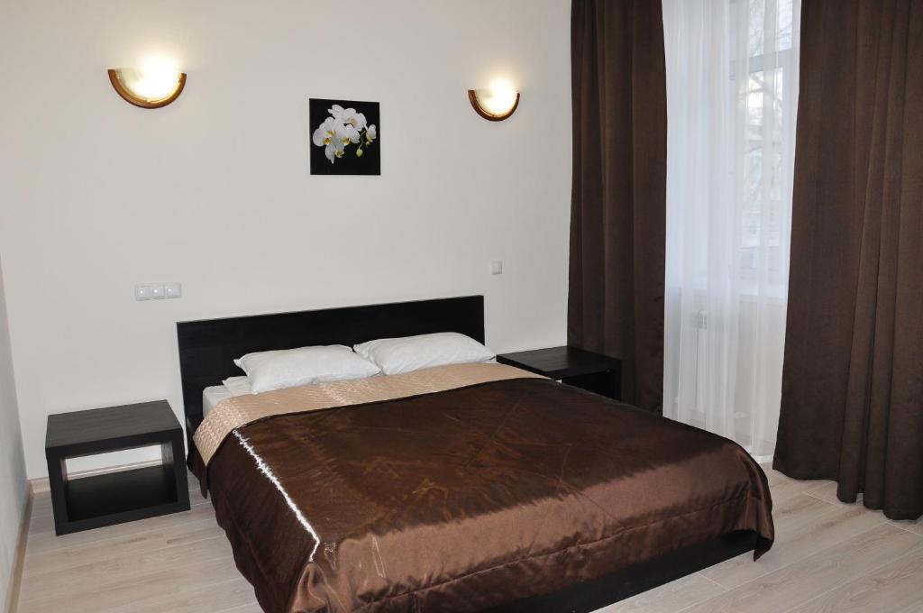 Кровать или кровати в номере Гостиница Славянка