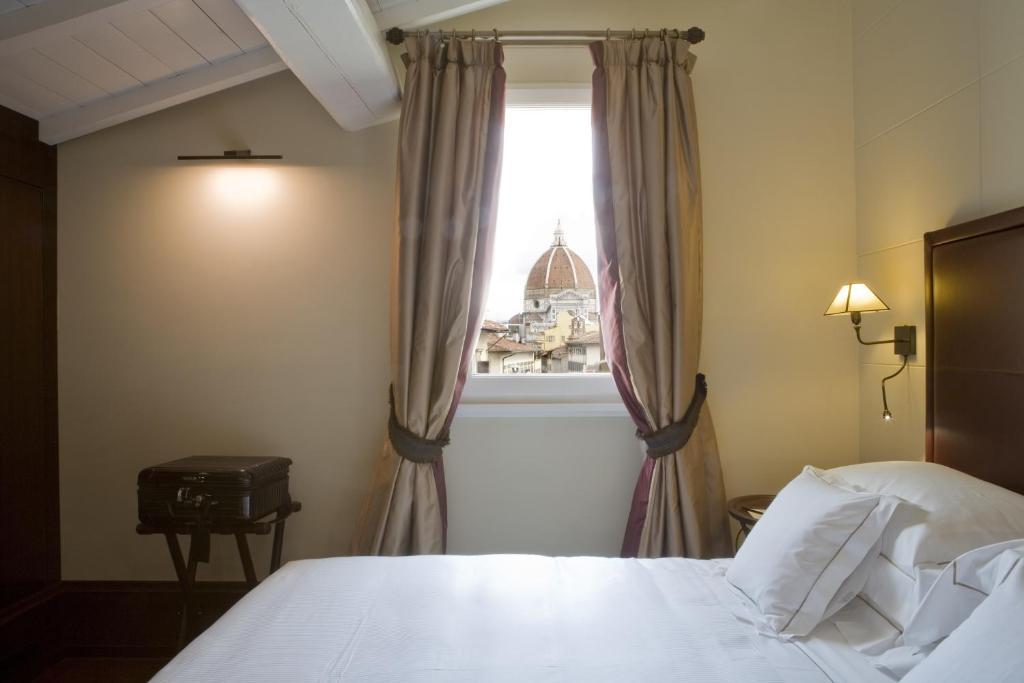 Letto o letti in una camera di Hotel L'Orologio