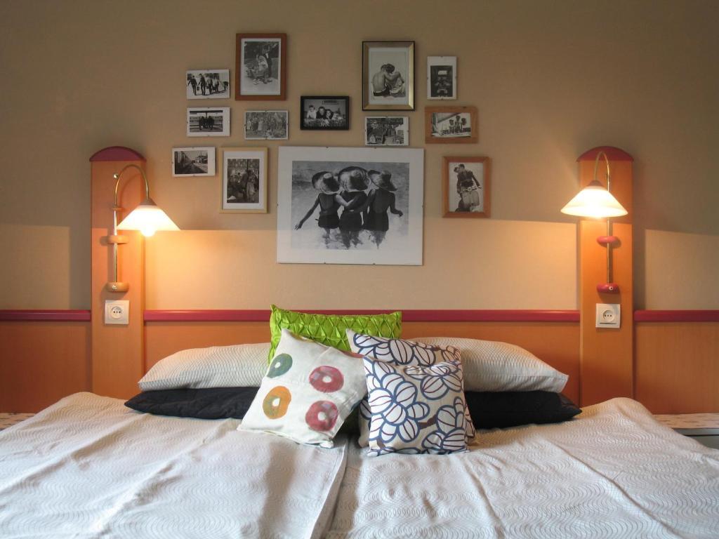 Łóżko lub łóżka w pokoju w obiekcie Willa Pod Aniołem