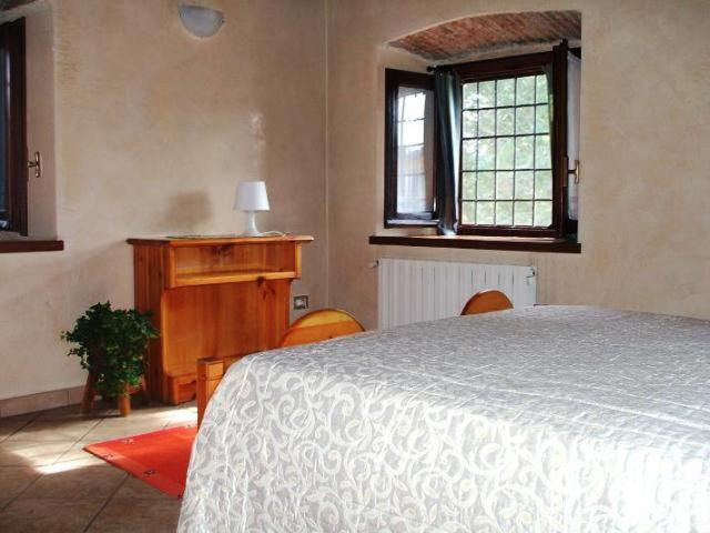 A bed or beds in a room at Bed & Breakfast La Corte