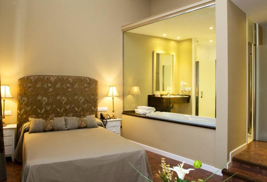 Cama o camas de una habitación en Hospederia La Querencia