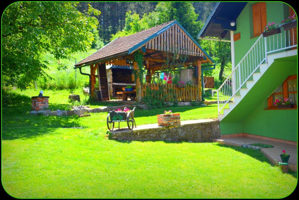 A garden outside Holiday Home Stara Lika