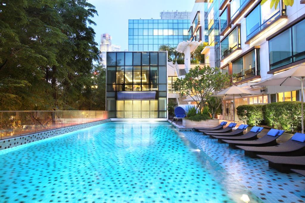 The swimming pool at or near Park Regis Singapore