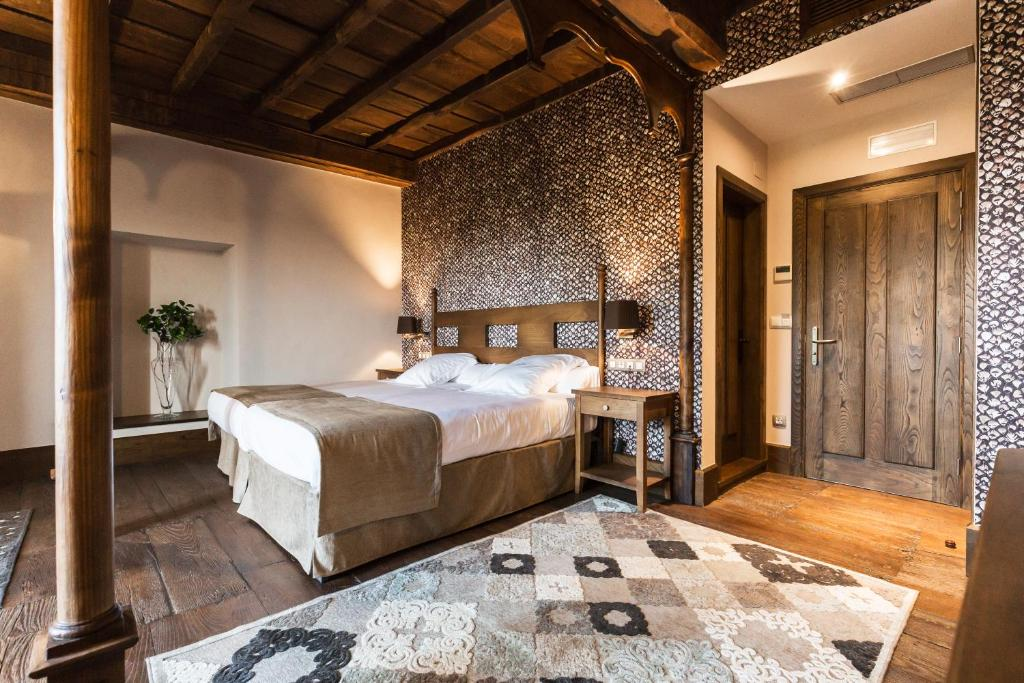 Cama o camas de una habitación en Pazo da Pena Manzaneda