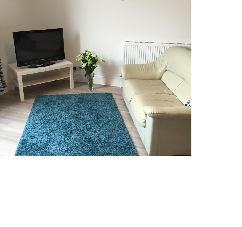 A bed or beds in a room at One Helena Road Serviced Apartments