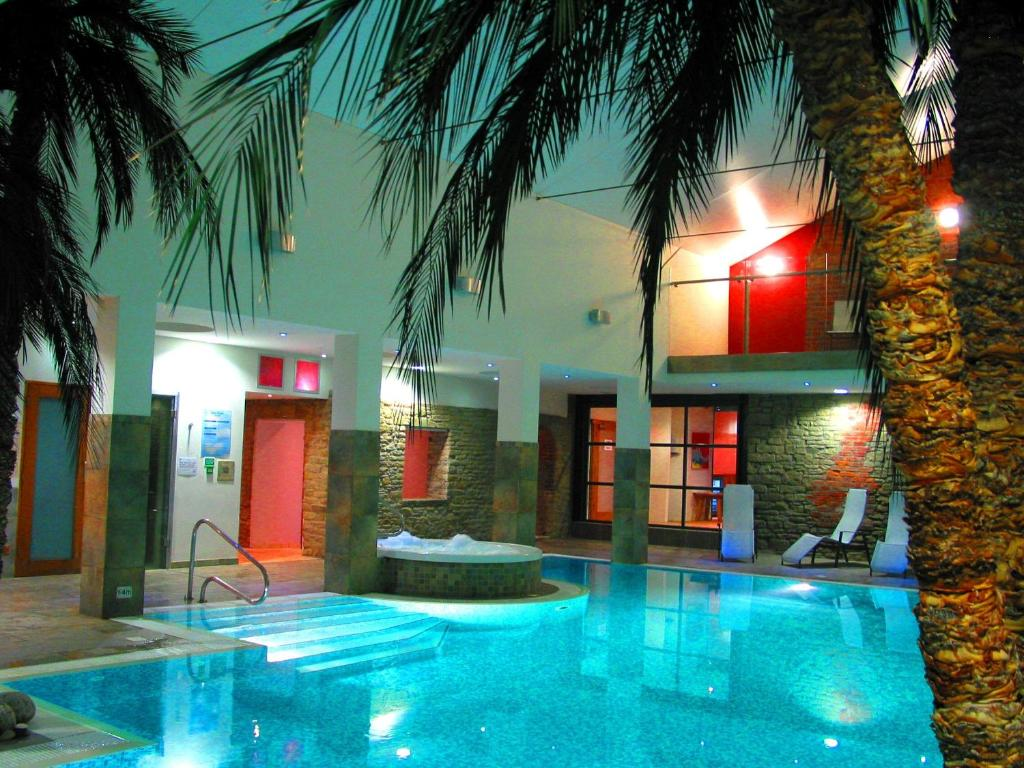 The swimming pool at or near Burton Hotel