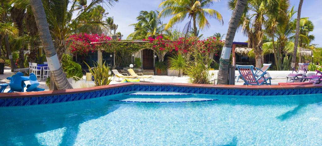 The swimming pool at or close to Beach House Aruba Apartments