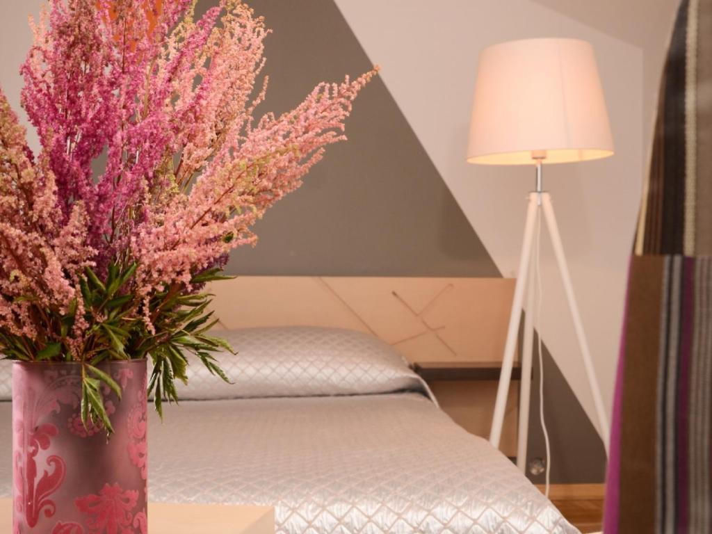 A bed or beds in a room at Mans Nams