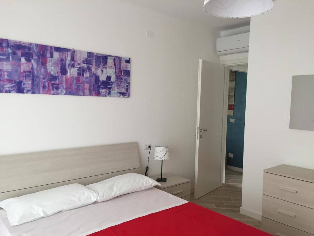 A bed or beds in a room at Appartamenti Stella Del Mare