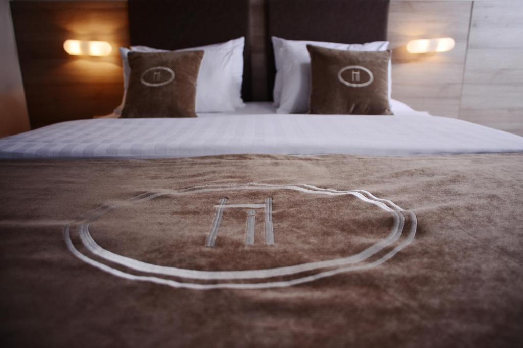 Ein Bett oder Betten in einem Zimmer der Unterkunft Hotel Ideja