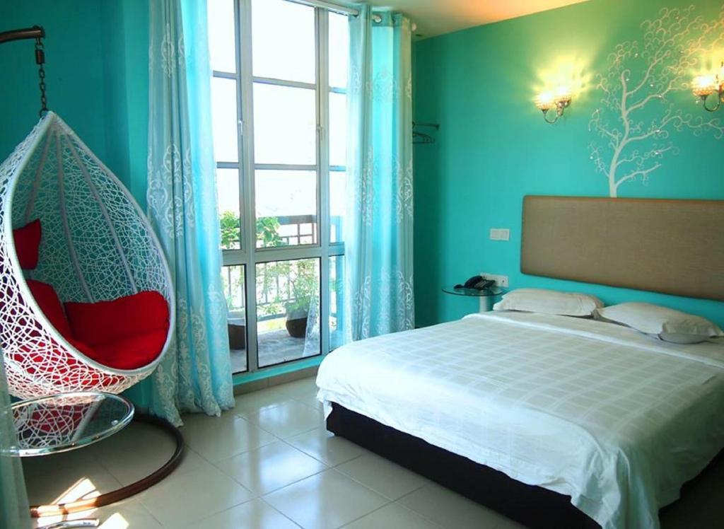 Ein Bett oder Betten in einem Zimmer der Unterkunft Angsana Hotel Melaka