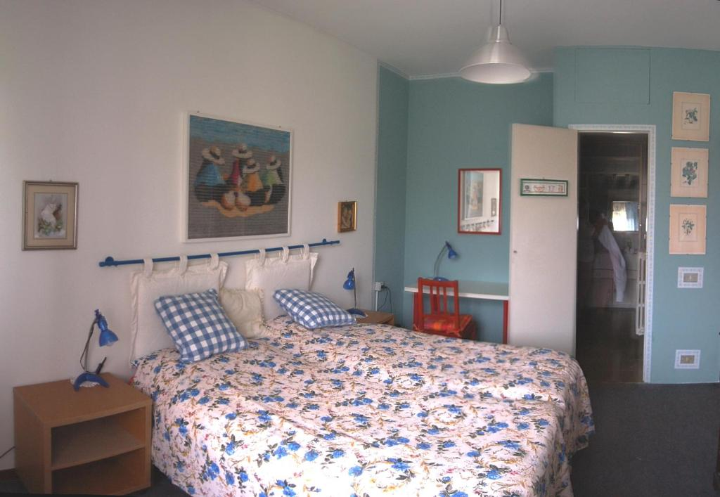 A bed or beds in a room at Guesthouse La Rocca