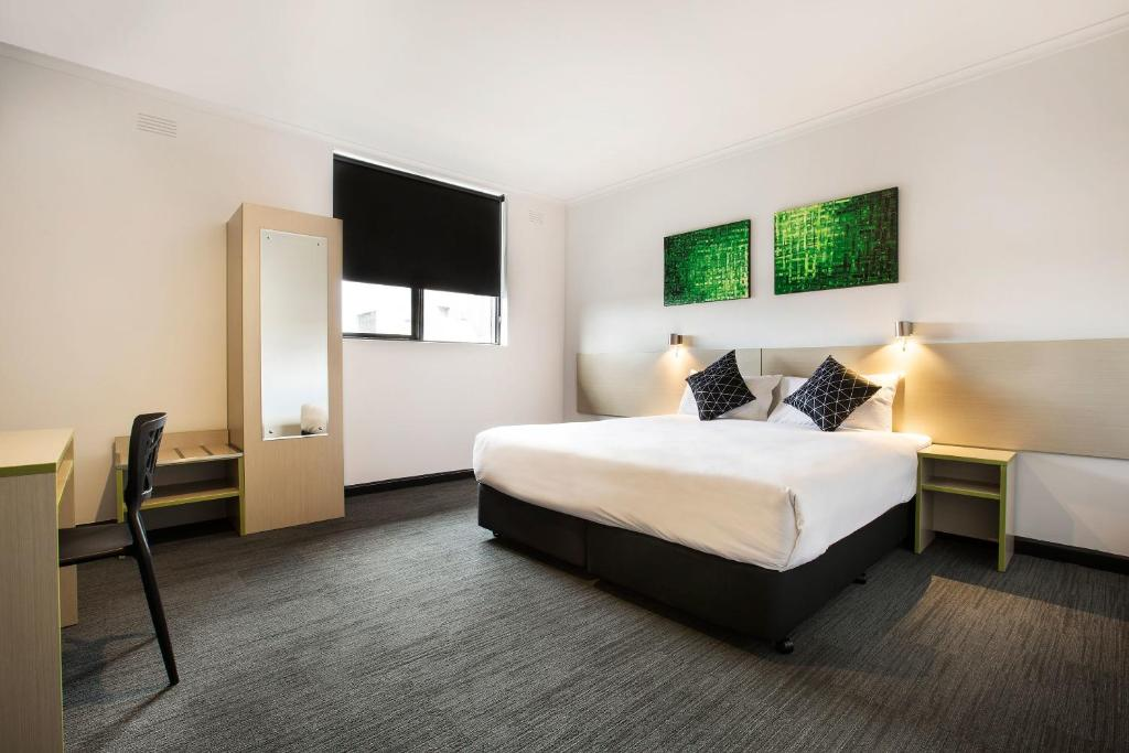 A bed or beds in a room at Nightcap at St Albans Hotel