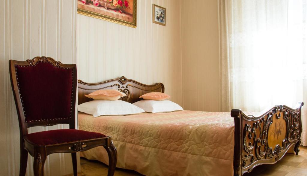 Кровать или кровати в номере Rooms at Mayakovskaya