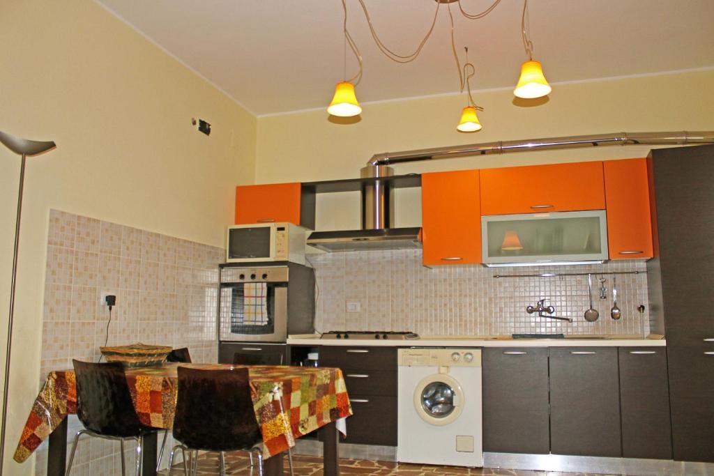Кухня или мини-кухня в Alghero 4u Self Check in