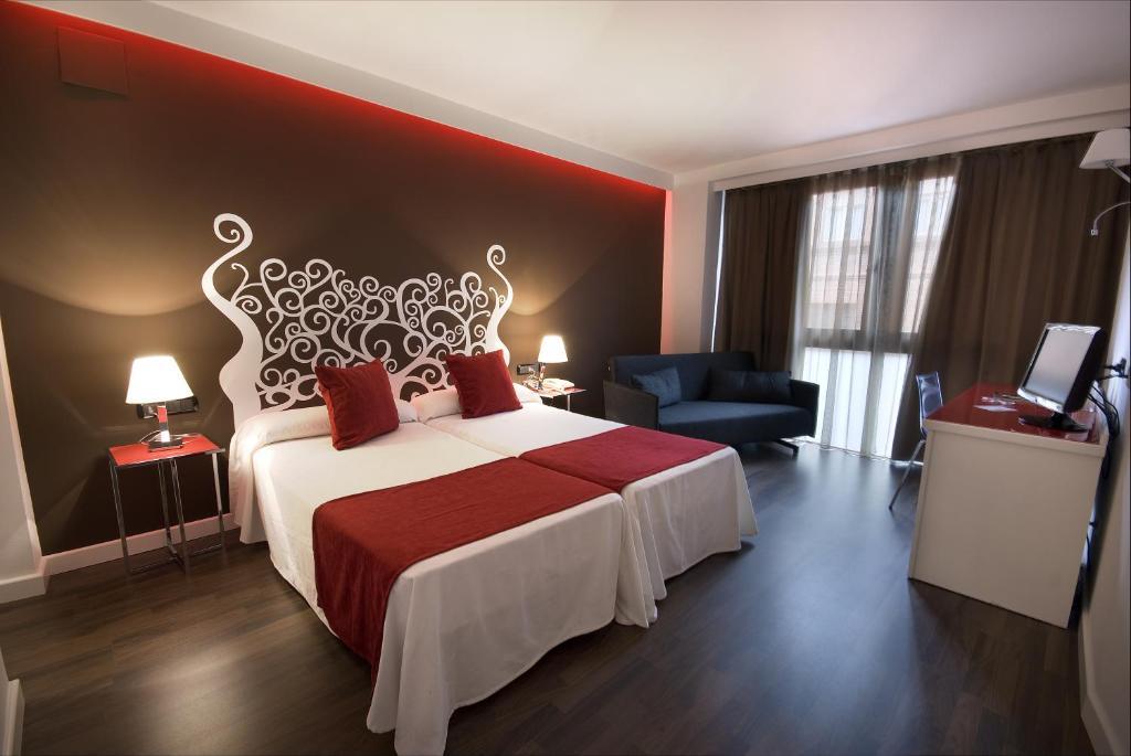 Cama o camas de una habitación en Hotel Teruel Plaza