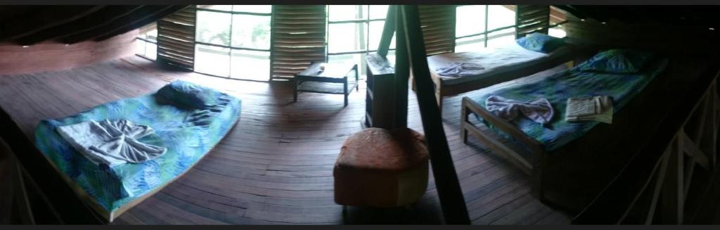 A bed or beds in a room at Acuali Ecohostal
