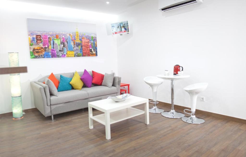 Zona de estar de Color Suites Alicante