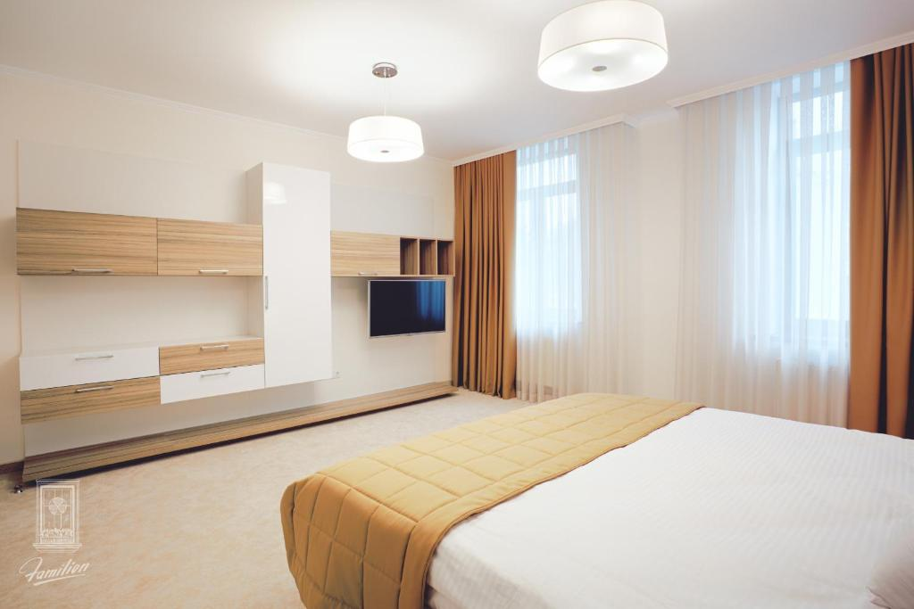A bed or beds in a room at Familion ApartHotel
