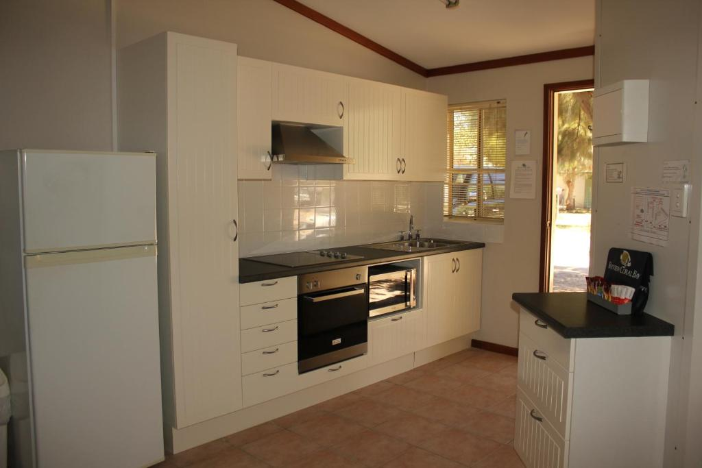 A kitchen or kitchenette at Ningaloo Coral Bay – Bayview