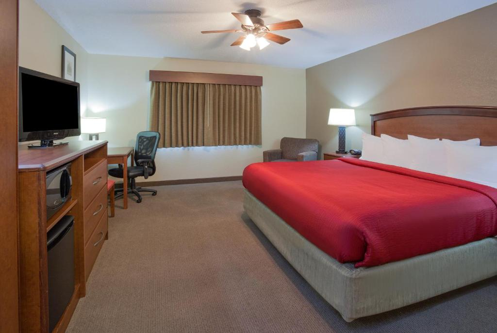 A television and/or entertainment center at AmericInn by Wyndham Roseau