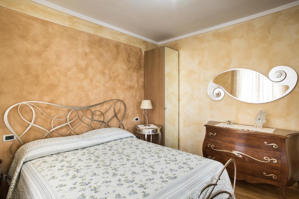 Letto o letti in una camera di B&B La Petite Maison