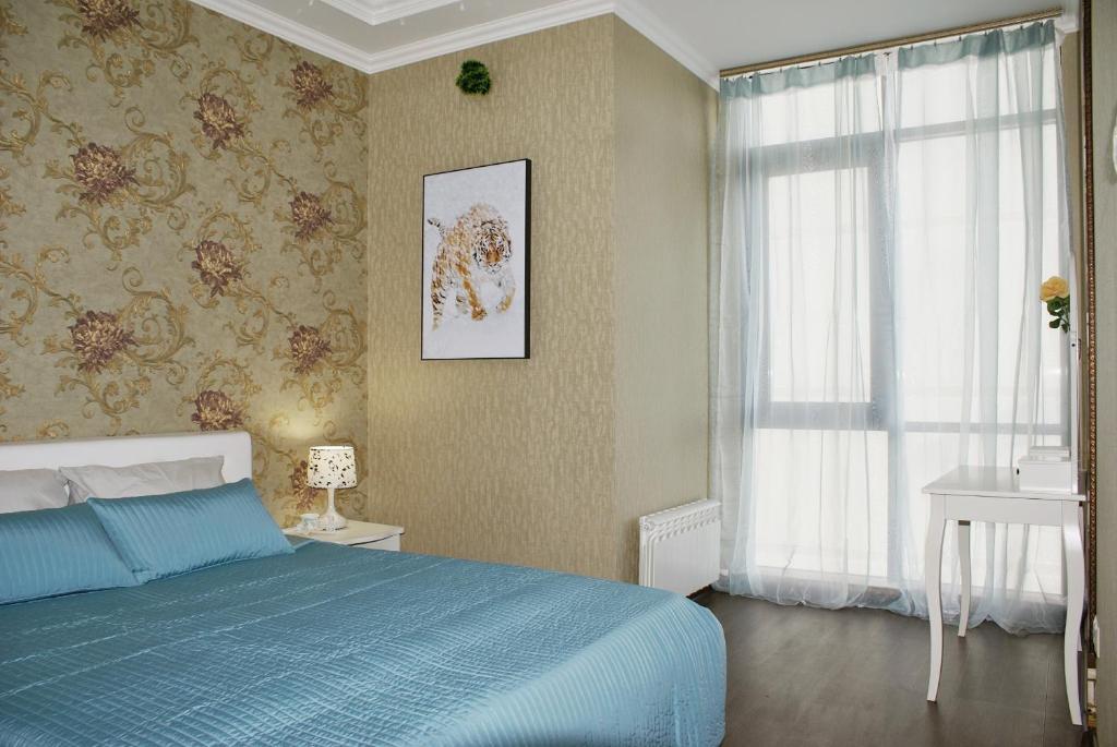 Кровать или кровати в номере Апартаменты на Луначарского