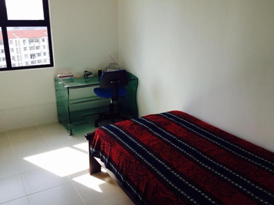A bed or beds in a room at Batu Ferringhi Beach @ Sri Sayang