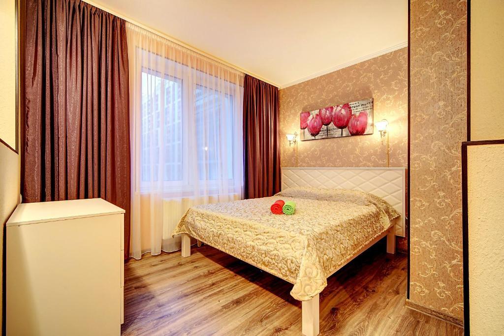 Кровать или кровати в номере U Moskovskogo Vokzala Apartment