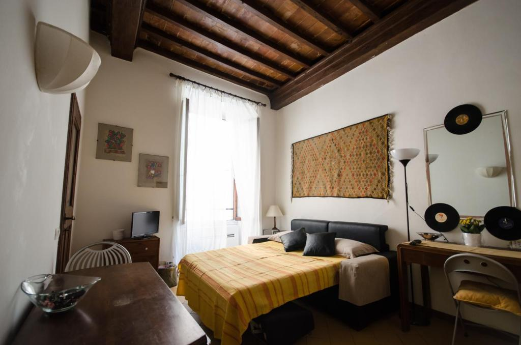 A bed or beds in a room at Corso 16 Apartment