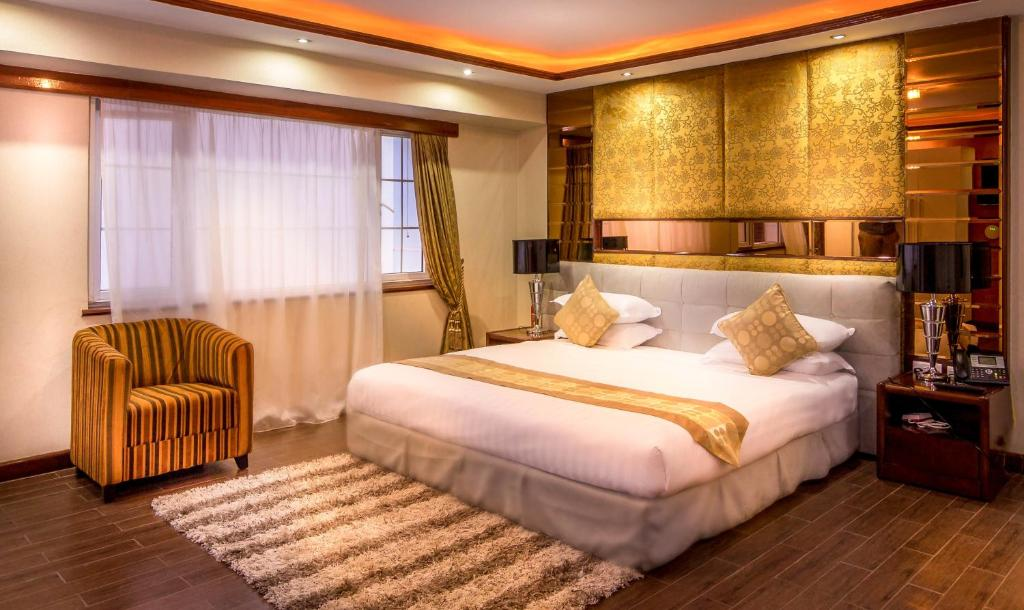 A bed or beds in a room at Clarence House Nairobi