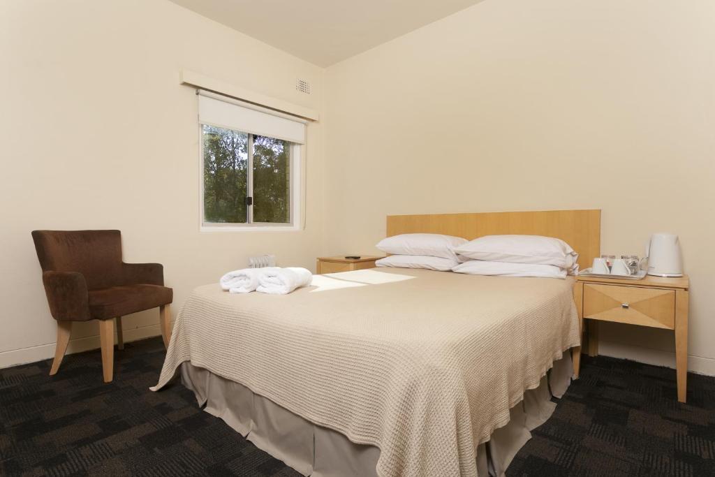 Кровать или кровати в номере Shortland Budget Accommodation