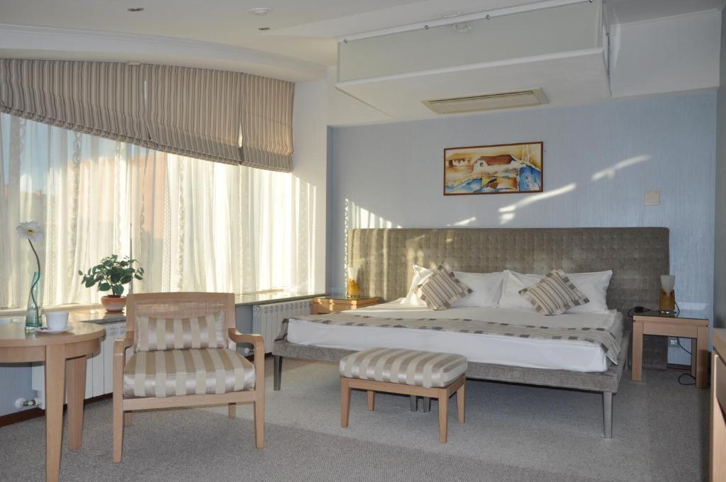 Кровать или кровати в номере Гостиница Персона