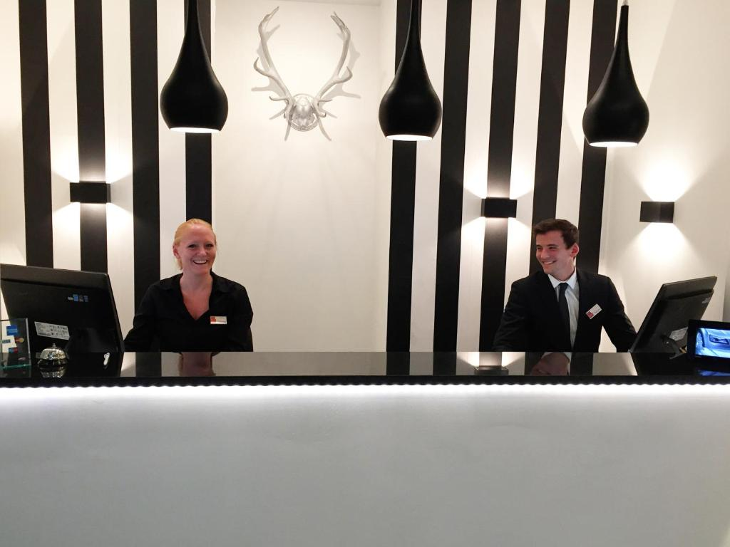 Staff members at Hotel Alt Deutz City-Messe-Arena