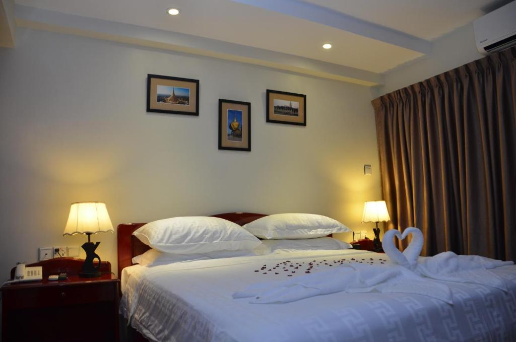 A bed or beds in a room at City Star Hotel