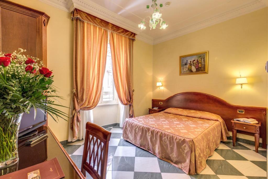 Un ou plusieurs lits dans un hébergement de l'établissement Hotel Contilia