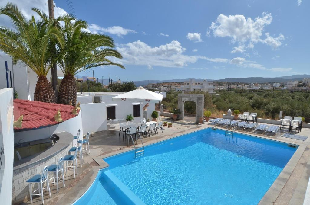 The swimming pool at or close to Manos Apartments