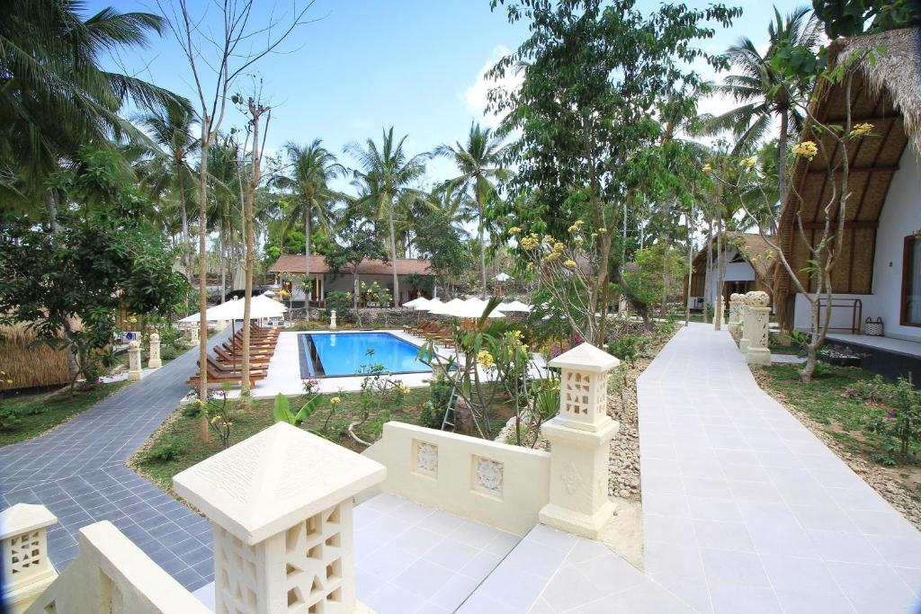 A view of the pool at Coco Resort Penida or nearby