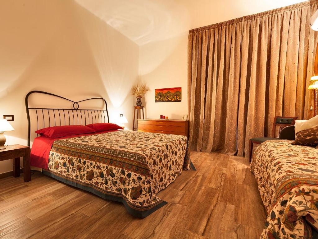 Letto o letti in una camera di B&B Casa Rossella