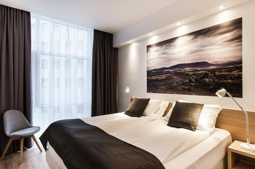 A bed or beds in a room at Storm Hotel by Keahotels