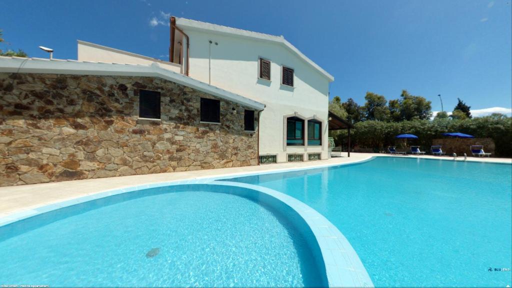 The swimming pool at or near Appartamento Gli Ontani