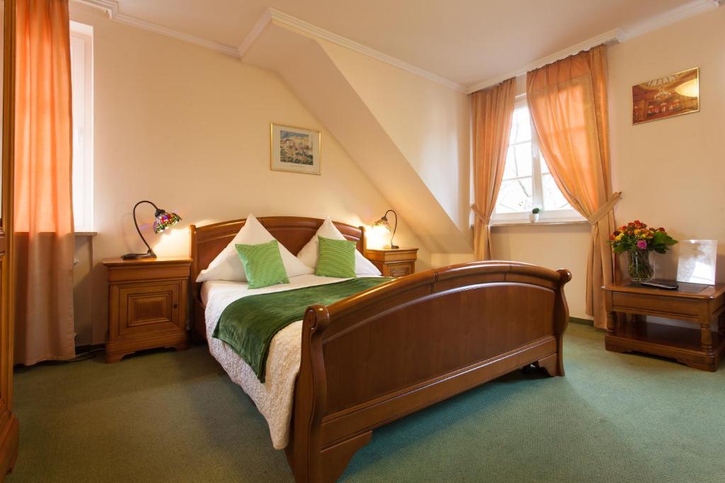 Ein Bett oder Betten in einem Zimmer der Unterkunft Hotel Athos
