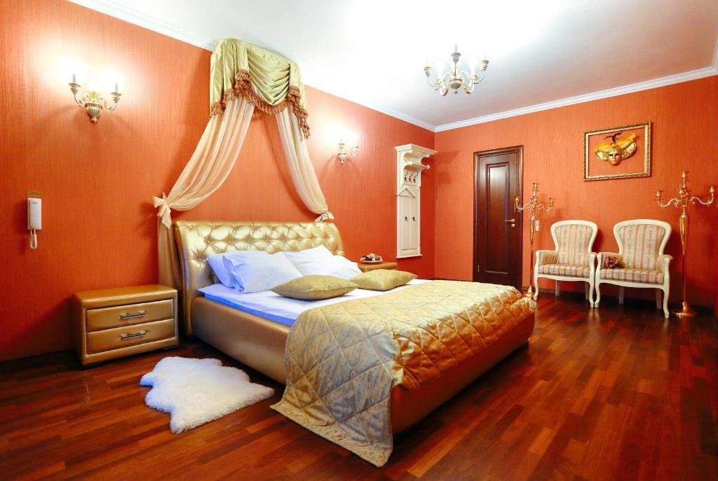 Кровать или кровати в номере Бутик отель Венеция